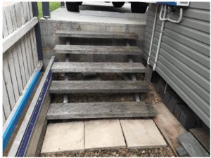 small flight of stairs no railing